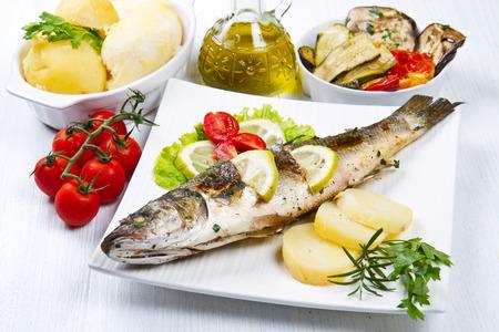 sea bass: fish, sea bass grilled with lemon ,salad and potatoes