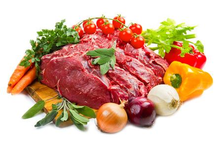 huge red meat chunk with vegetables isolated over white background  photo