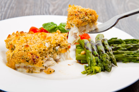 breadcrumbs: cod fish with crispy breadcrumbs and asparagus