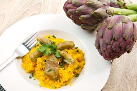 Italian risotto with artichok photo