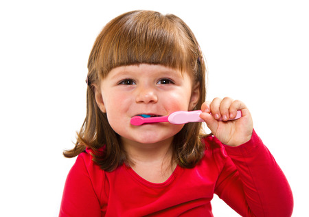 Little Smiling Curly Girl Brushing Teeth Stock Photo - 27684767