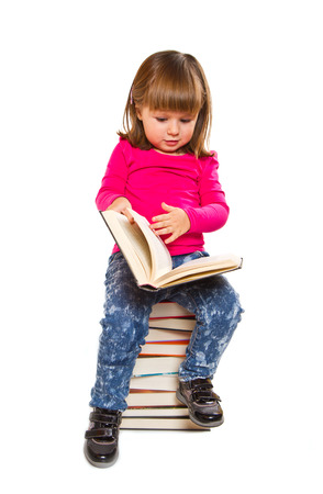 Little girl sitting on stack of books  Stock Photo - 27684800