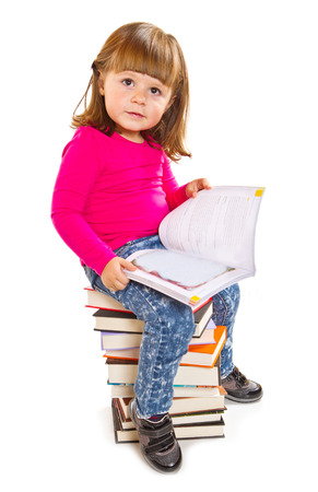 Little girl sitting on stack of books Stock Photo - 27684805