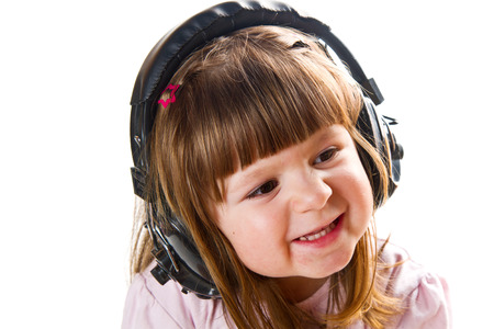 Beautiful cute happy little girl with headphones Stock Photo - 27684192