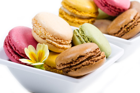 white bowl with colored macaroons photo