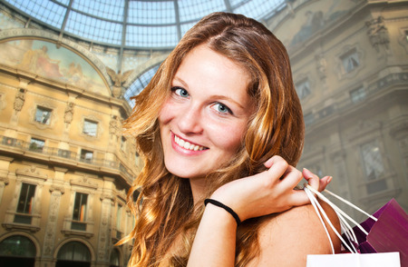 smiling girl with shopping bags in Milan photo