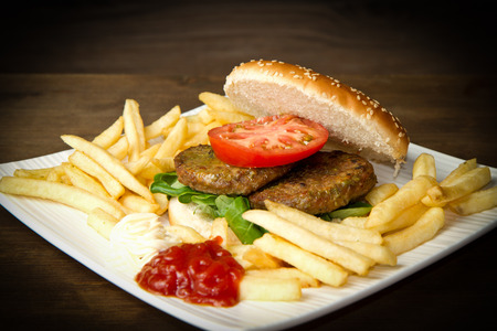 hamburger with potatoes on wooden background  photo