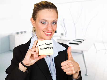 business woman holding a card photo