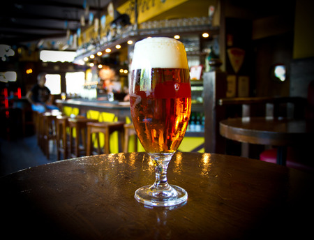 brewery: Glass of light beer on a pub