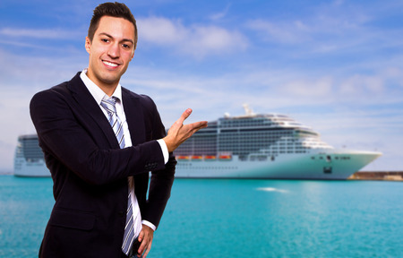 lifeboats: Young man show the Cruise Ship Stock Photo