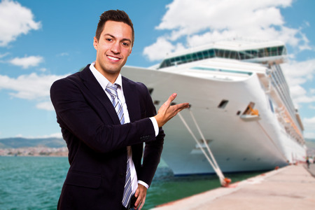 anchoring: Young man show the Cruise Ship Stock Photo