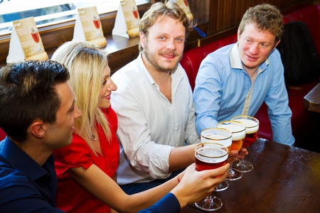 Friends with beer in a pub  photo