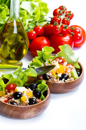 spelt salad with tomatoes and olives on white background photo