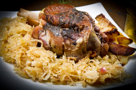 pork knuckle baked with sauerkraut  photo