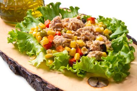 mais: tuna salad with mais and cob on wood board