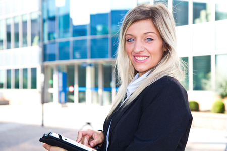 Successful businesswoman with tablet photo