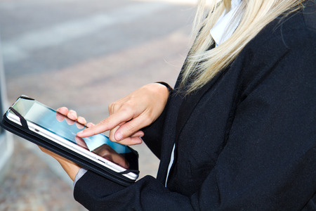 female hands touching digital tablet photo