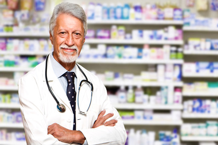 portrait of a male pharmacist at pharmacy photo