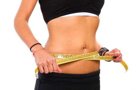 abdomen plano: Una medición de la cintura delgada chica