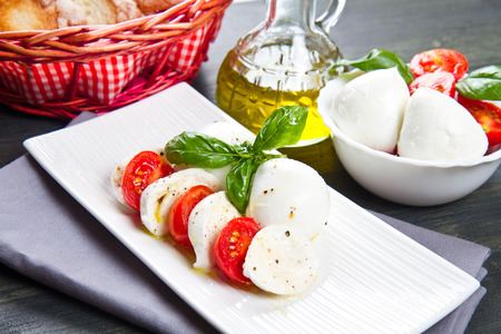 mozzarella, tomatoes and basil photo