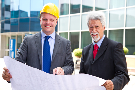 young engineer showing something to His partner at building site