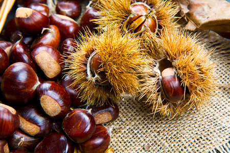 marron: Chestnuts on an old board.