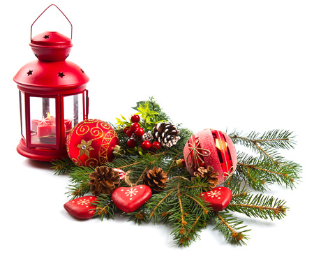 Christmas balls and fir branches with decorations isolated over white photo