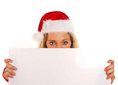 Christmas pretty woman peeking from  blank sign billboard isolated photo