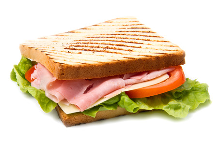 sandwich with ham, cheese and tomato isolated on white background photo