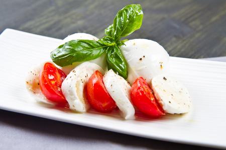 caprese salad: mozzarella and basil with tomato