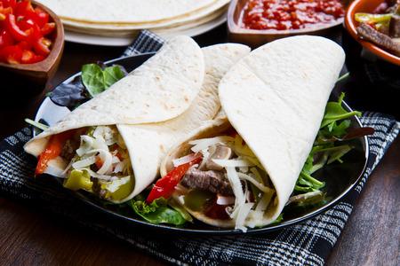 fajita: Homemade Chicken and Beef Fajitas with Vegetables and Tortillas Stock Photo