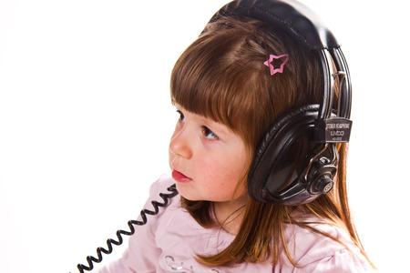 wildcard: Beautiful cute happy little girl with headphones