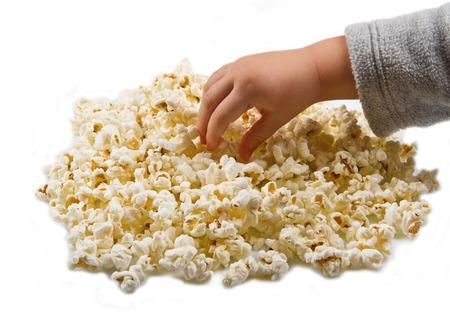eating popcorn: Hands of children eating popcorn Stock Photo