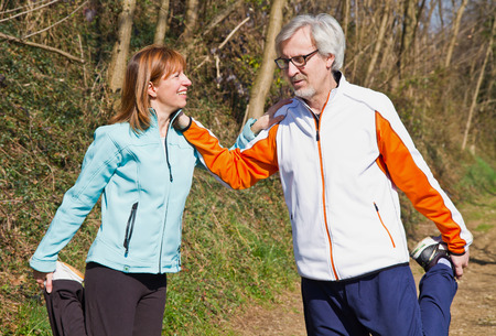 Senior couple doing their running exercises. Stock Photo