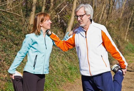 excercise: Senior couple doing their running exercises. Stock Photo