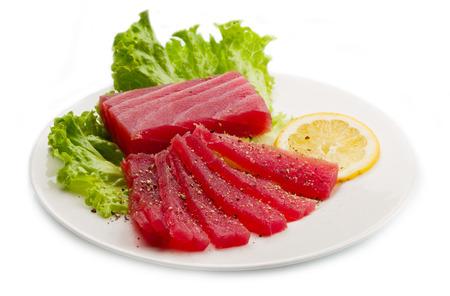 Slices of raw bluefin tuna  sashimi on white dish
