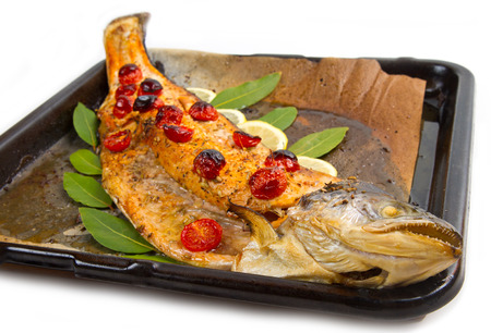 entire: entire salmon cooked with tomatoes ,lemon and laurel