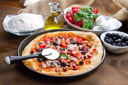 mais: american pizza with salami,beans and mais Stock Photo