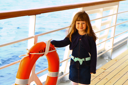 ble: little girl standing on deck of cruise ship