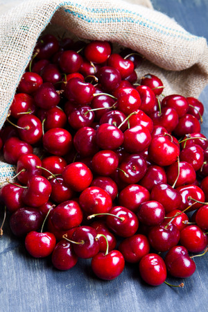 nutriments: cherry on wood Stock Photo