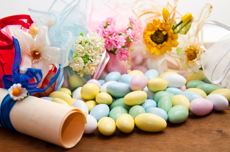 sugared: sugared almonds color blue, rose,  yellow  and white.