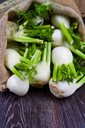 Fresh fennel on wooden background Stock Photo