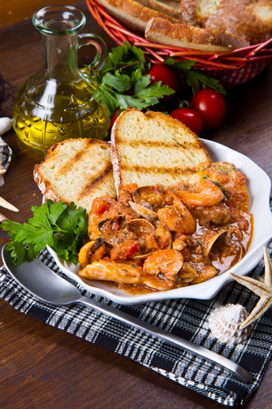 seafood soup: white dish of fresh seafood soup Stock Photo