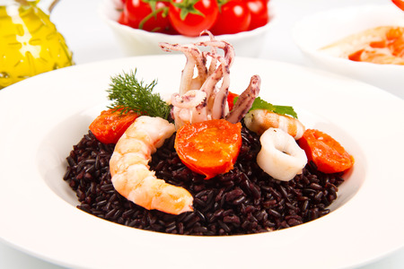 tomates: black rice with squid , prawns and tomatoes