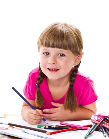 ni�os con l�pices: preciosa ni�a escribiendo en el escritorio