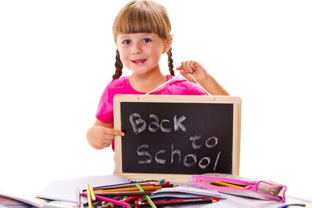 schoolchild: Happy smiling schoolchild holding small blackboard with text back to school
