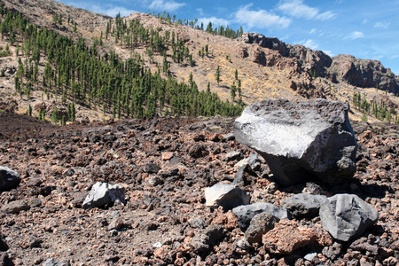 stone volcanic stones: Lava and peak of Teide volcano. Tenerife, Canary Islands, Spain