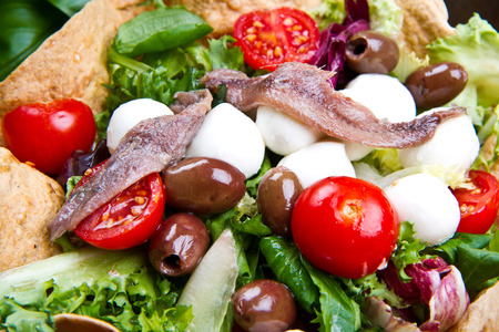 good cholesterol: mixed salad in bread basket