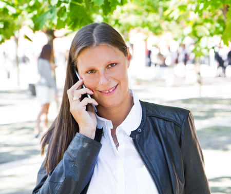 woman on phone: beautiful woman talking on cell phone Stock Photo