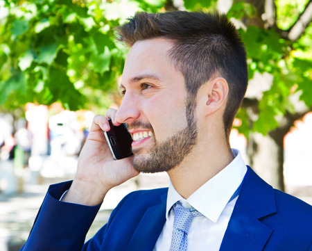 business man phone: Business man speaking on the phone